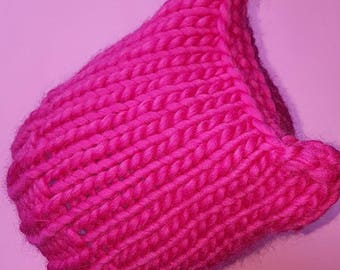 The handknitted Puddy Cat Hat in Hot Pink