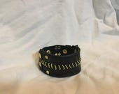 Black and gold chained le...
