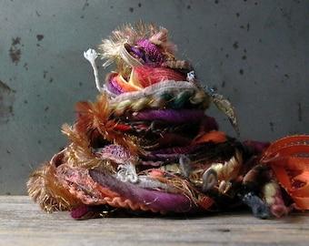 random thoughts 25 fringe effects™ . fiber art yarn bundle 21yd handspun wools hand painted ribbons novelty yarns . gold purple orange