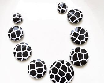 salvaged black and white cobble stone design flat round disk beads in graduating sizes--mixed lot of 9