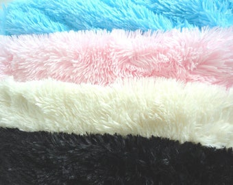 Padded pillow made or fake fur in many different colors.