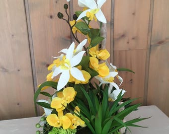 Artificial arrangement in shades of yellow, Orchid, yucca and Driftwood