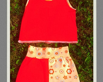 Set of T-shirt without sleeves & short baggy trousers 6-12 months