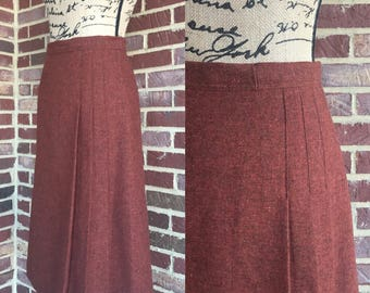 "Vintage 1970s burnt orange wool straight skirt with pleating down front on one side size small 26"" waist"