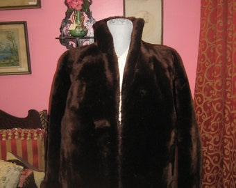"1950's, 40"" bust, deep brown mouton jacket."