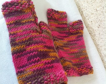 Hand knitted pink mittens