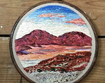 Hand embroidered red desert thread painting