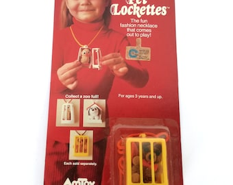 Pet lockettes the faun fashion necklace that comes out to play, by Amtoy made in taiwan 1980
