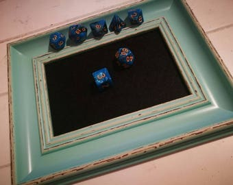 Light green dice tray with black felt.