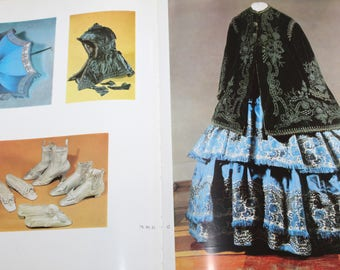 The book is about costumes and women's dresses in Russia 18-20 century. Suaer cover, Catalog.