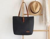 Dark navy tote / diaper bag / shoulder bag, leather handles, 9 inside pockets. Waterproof lining available