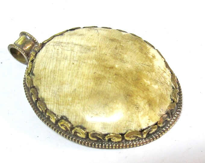 Large oval shape Tibetan brass Repousse naga conch shell tribal design pendant with reverse dragon carving  - PM406TL