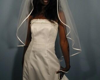 "Wedding veil fingertip length 42"" long with folded satin ribbon 1/4""."