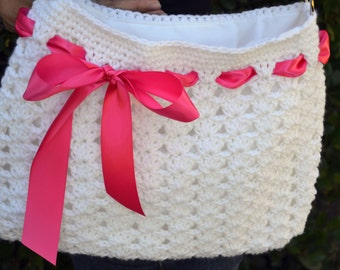 Crochet shoulder purse, tote bag with ribbon in white and pink.