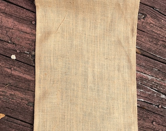 A Roll of Natural Burlap/Jute Runner. Hand Made, Eco friendly, Biodegradable folded sewn-edge Size: 11 inches wide and 78 inches long.