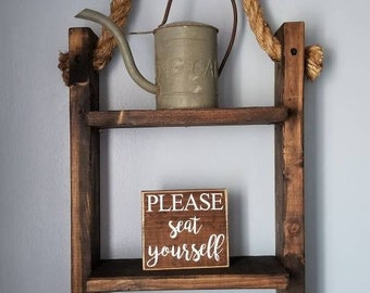 Hanging wood shelf with roped hanger