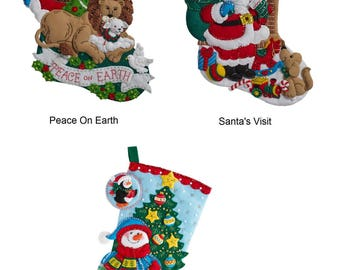 Bucilla Felt Applique Stocking Kit - Peace On Earth (86665), Santa's Visit (86702), Trimming The Tree (86659)