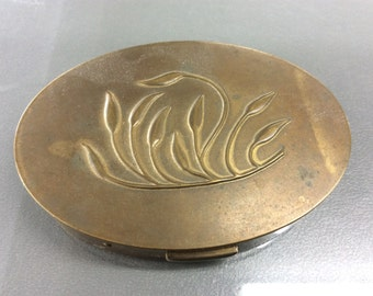 Woman's vintage compact in good condition
