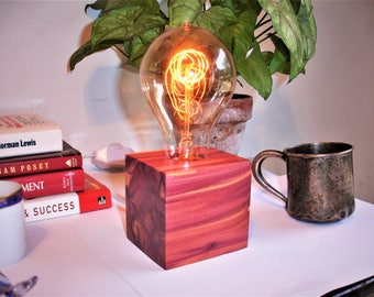 Richly colored red cedar table lamp. IN-LINE DIMMER switch.  Edison old world style globe bulb.