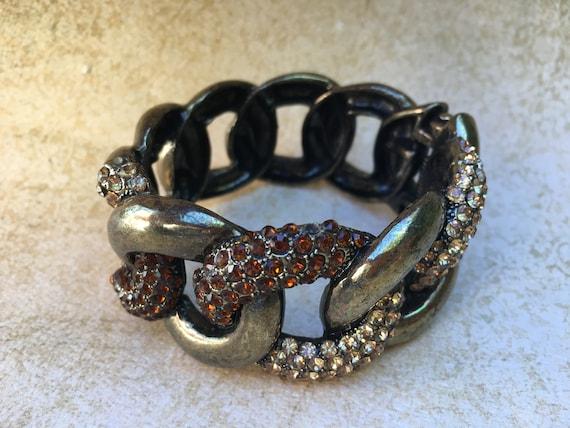 Gold Tone Rhinestone Clamper Bracelet by https://www.etsy.com/shop/JNPVintageJewelry