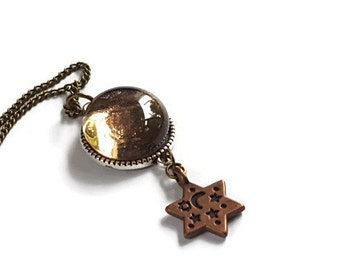 Star pendant with brown glass cabochon and bronze star