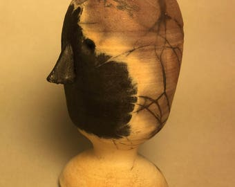 One of a kind stylized wheelthrown  unglazed head, pit fired in BBQ