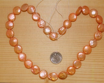 """Freshwater Coin Pearl Strand, 12x5mm beads, cultured pearls, one 16"""" strand, peach pearls (Dp106)"""