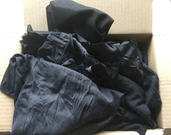 Black fabric scraps grab box