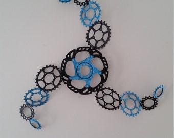large vortex bike gear wall sculpture