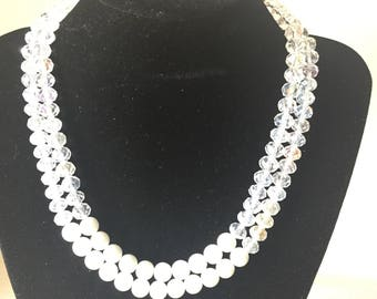 White beaded necklace with lines and finished with white glass round beads