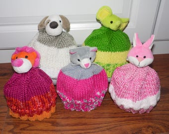 """Knitted toddler winter hats with """"Top It"""" accents"""