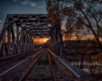 Train bridge into sunset, Mississippi River, Minneapolis, Minnesota