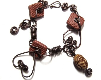 Double Heart Bracelet with Hand Formed Copper Closure, Handmade Copper Springs, Textured Square Clay Beads and Hand Carved Monk Bone Bead