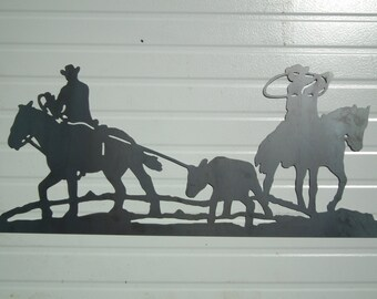 Team roping metal sign.