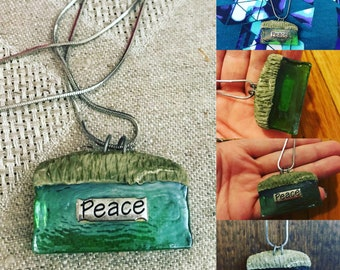 Handmade glass peace necklace