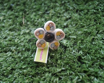 Electric yellow and white flower ring