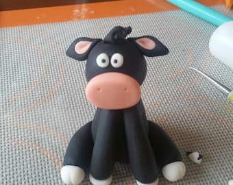 Edible fondant silly cow cake cupcake topper.