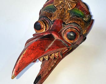 Old wooden mask from Indonesia used for rituals.