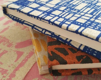 A5 sized hardback in screen printed Bright navy Overlap fabric by Lucie Summers.