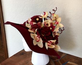 Wine felt heat with cream orchids
