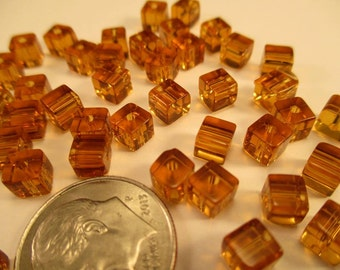 Package of 40 Amber Color Glass Cube Beads 4mm.  Item:BC818771