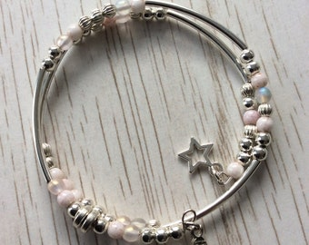 Pretty stacking bracelet in shades of silver, opaque and pale pink