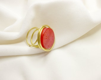 Impressive handmade ring with bright red bead and golden wire