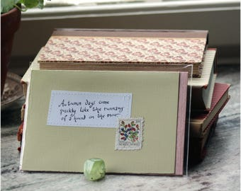 Autumn days come quickly like the running of a hound on the moor Pale beige card with handwritten quote and Swedish postal stamp