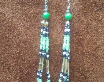 Sage, white, and black beaded dangling earrings