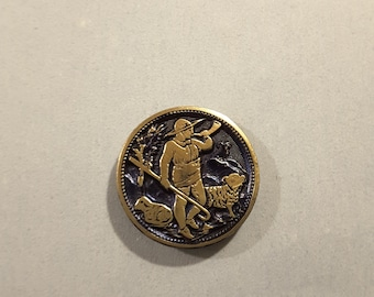 Vintage metal button of a shepherd and sheep.