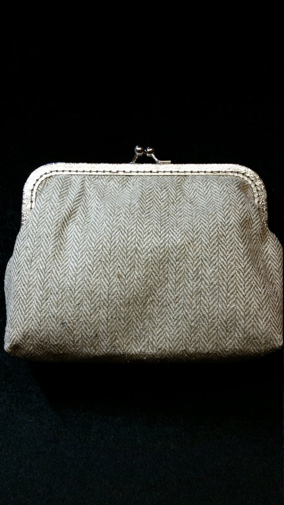 L505.  Clutch bag in pale green  herringbone tweed.