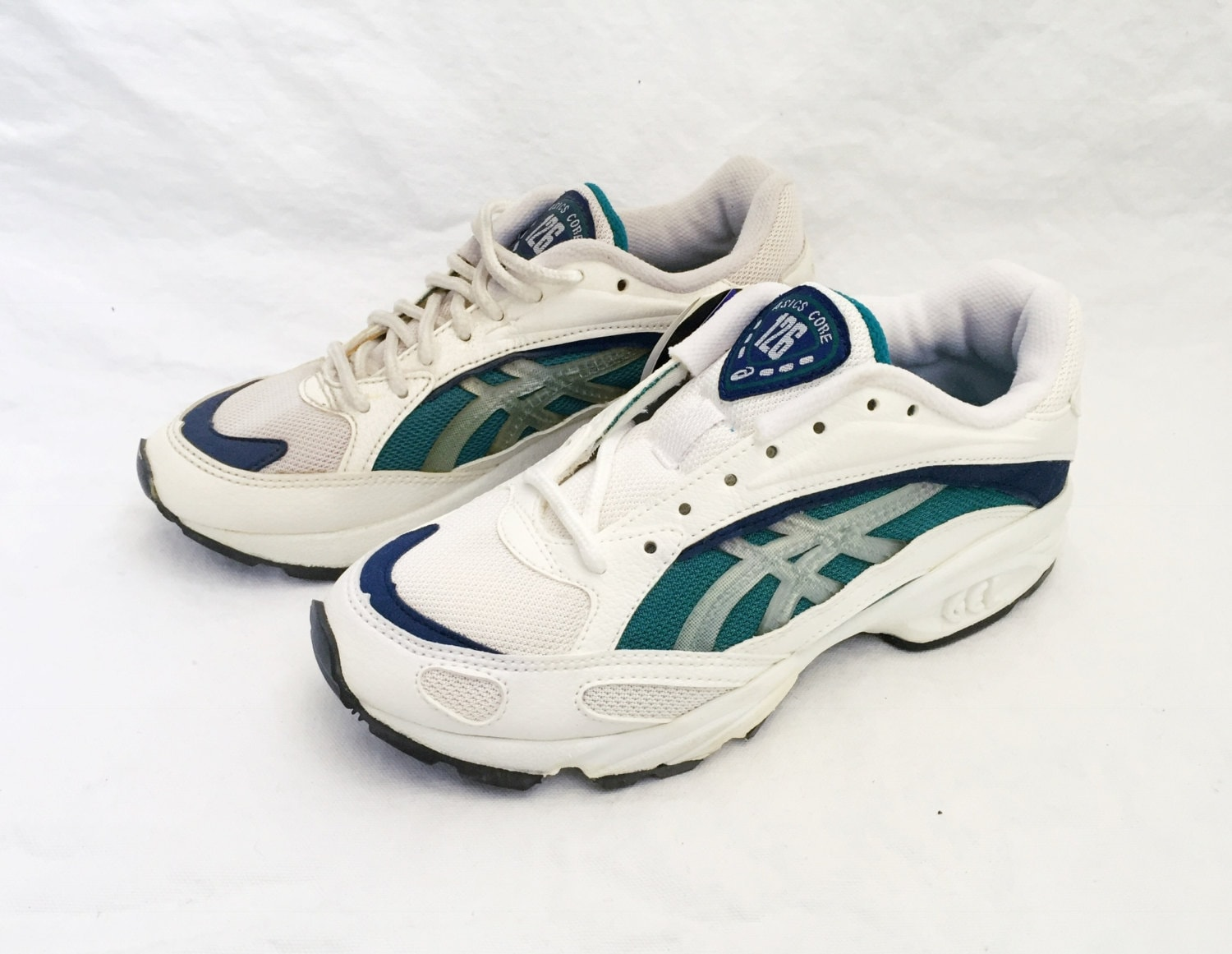 Description. 1996 Asics sneakers.