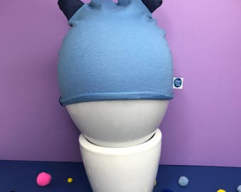 Baby cap in light blue cotton Fleece candy paper