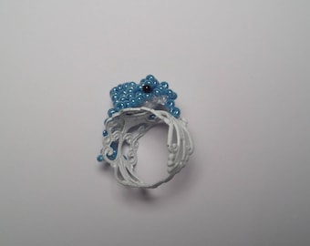 White Adjustable ring, small seed beads, white and Blue Dolphin